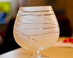 wrap rubber bands around goblet and spray with frosted glass paint--great idea!  Pick up odds and ends glasses at S.A., spray, then put small candle in for mother/daughter slumber party