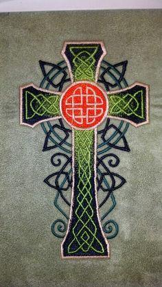 Celtic cross on green suede.