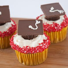 """All you need are mini peanut butter cups and a chocolate bar that can be broken into squares.  1. Bake and frost cupcakes   2. Put an unwrapped mini peanut butter cup upside down on top of each cupcake  3. Using a dot of frosting as """"glue,"""" place a chocolate square on each cup   4. Using a Wilton Cake Decorating #2 frosting tip, pipe the tassel on the chocolate squares   Match sprinkles to your school colors for extra festivity"""