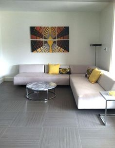 more #MMexamples... minimal living room: a few touches of yellow to keep it warm and bright | Art from Linda Parker via Modern Mural
