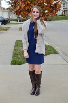 cute outfit ideas for thanksgiving, navy shirt dress with a cozy sweater and riding boots, what to wear for holiday gatherings, navy dress outfit idea, chocolate brown riding boots, how to wear dresses with boots, a memory of us