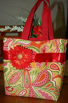 I would love to make one for each of my boys for all of there things.  they would be great church bags for all their coloring projects.