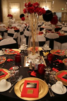 "Red, black and gold table decorations for 50th birthday party. ""Red Carpet Affair"""