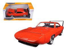 1969 Dodge Charger Daytona Orange 1/24 Diecast Model Car by Jada - Brand new 1:24 scale diecast model car of 1969 Dodge Charger Daytona Orange die cast car model by Jada. Rubber tires. Brand new box. Detailed interior, exterior. Has opening hood, doors and trunk. Made of diecast with some plastic parts. Dimensions approximately L-8, W-3.75, H-3.25 inches. Please note that manufacturer may change packing box at anytime. Product will stay exactly the same.-Weight: 2. Height: 6. Width: 11. Box…