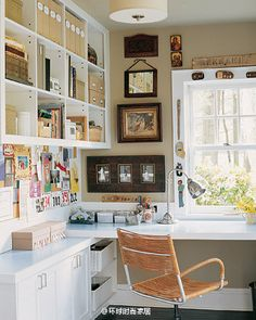 This would make a good corner in the sewing room... nice and bright by the window... lots of shelving for quilt books.