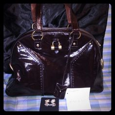 ysl classic duffle bag - $1100 This is an authentic YSL YVES SAINT LAURENT Leather Medium ...