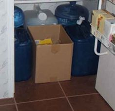 Water storage, along with a box of recycling, has the bottom shelf of our kitchen closet. Reassuring!