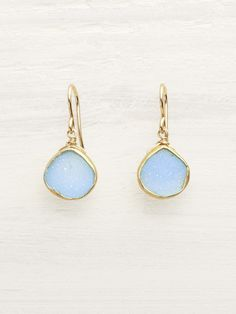 Raw crystalline teardrops of periwinkle-hued, baby blue Druzy, show off the magical inner geodes of natural Agate Rocks. These exceptionally beautiful and unique crystallized rock earrings are framed
