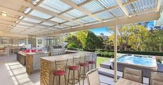 Outdoor kitchen and entertaining area with tiled covered patio with clear laserlight roofing . #outdoorkitchens #bbqarea #roofing | Pinterest