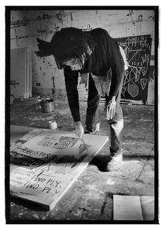 Jean-Michel Basquiat by Roland Hagenberg in his Crosby Street studio. 1983