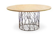 Enchanted Dining Table by Koket. Koket's artisans have masterfully captured the alluring essence of an enchanted forest with this dining table. Its antique gilded branch like structure can't help but mesmerise the beholder. Top in birds eye veneer complimenting a cast brass oxidised gold plated base.
