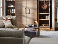 Handcrafted of solid oak wood, the Arhaus Baumann Media Wall Unit in Ashland Natural features rustic sliding doors for additional storage. Bookcase Wall Unit, Living Room Bookcase, Living Room Wall Units, Home Living Room, Bookshelves, Modular Furniture, Furniture Decor, Living Room Furniture, Small Space Living