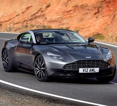 The Aston Martin is one of the most elegant grand tourer supercars available. Available in a couple or convertible The Aston Martin has it all. Aston Martin Lagonda, Carros Aston Martin, Aston Martin Sports Car, Aston Martin Db11, Aston Martin Vulcan, Maserati, Bugatti, Supercars, Moto Design