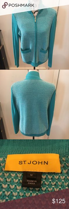 St. John Wool Color Block Zip-up Sweater, Medium Check out this beautiful 100% wool sweater from St. John I purchased at Nordstrom. Such a soft, comfortable feel, yet very classy and chic for work or play. I love the bold color-block look, and the bright teal color is stunning! Size medium, excellent used condition (worn once), zip-up front closure (gold hardware) and two front pockets. Bring on the compliments with this high quality designer staple! 💕 St. John Sweaters