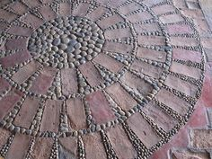 Mosaic art stems far back as 4000 years. However it was the Greeks who took the pebble art forming to a higher level, somewhere in the eighth century.
