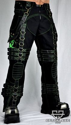 Biohazard Decay Pants Male  Black Cotton/Microfiber Pants with UV Green Stitching, Black Pleather Belt Loops, Knees and Detachable Straps, Rivet Detail throughout, UV Green Biohazard Prints, 2 Hidden Zipper Side Pockets, D-Ring Detail, 6 Buckles down each of the Legs and a Zipper and Snap Closure.
