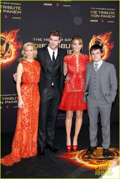 I can't believe that the girl in the Orange dress is the same person that plays Effie Trinket!