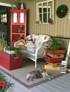 Porch with wicker and pepsi, coca cola crates, and ferns