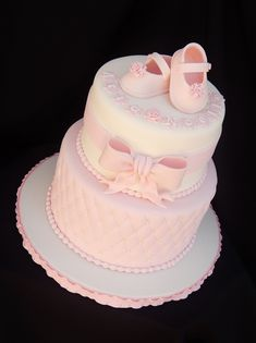 fondant baby shoes - 7/9 vanilla cake with raspberry filling - baby shower cake with quilted diamond pattern