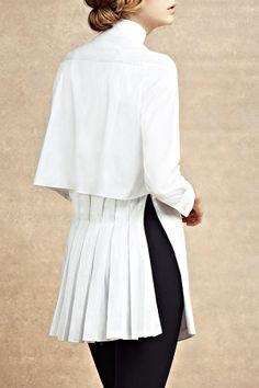 McQueen's beautiful pleats back it up.