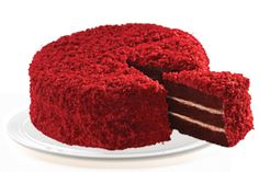 Southern Red Velvet: Moist and velvety chocolate cake layered with a smooth and decadent cream cheese frosting and garnished with crushed nut and coconut macaroons.