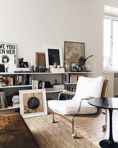 low shelves with art and books. / sfgirlbybay