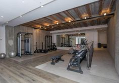 Look at this amazing home gym! Dumbbell set, racks, benches! amazing