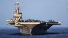 The USS Abraham Lincoln, a Nimitz-class aircraft carrier, is seen near the coast of Indonesia in 2005.