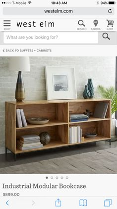 Beautiful low wooden bookshelf West Elm