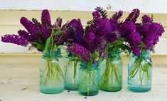 Purple flowers in coloured mason jars, floral arrangements, tablescape ideas, DIY bride, DIY wedding