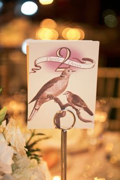 12 Days of Christmas as Table Numbers. How clever! Photography by judypak.com, Floral Design by petalinyc.com