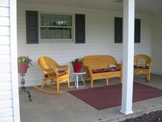 We love receiving pictures of porches from readers. They share all types of porches: country porches, wrap around porches, small porches, spacious porches. Thank you for sharing your porch pictures with us! Pictures Of Porches, Porch Railing Designs, Small Porches, Front Porch, Concrete, Windows, Yellow, Red, House