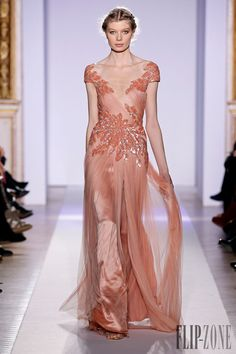 Zuhair Murad Official pictures, S/S 2013 - Couture - http://www.flip-zone.com/fashion/couture-1/fashion-houses/zuhair-murad-3366 - Long fluid dress in salmon silk tulle, asymmetrical cleavage ornamented with plumage of embroidered pearls and crystals.