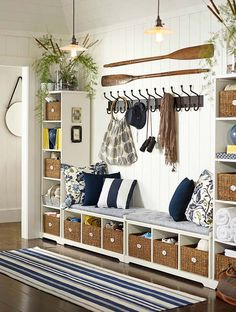 I love this idea for either an entry way or a hallway off the entry...perfect storage, sitting area, baskets for everyone to store their stuff  coat hooks. Great!