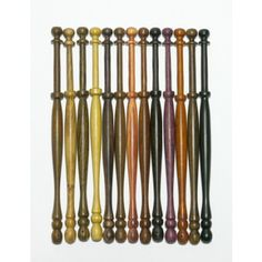 Wooden bobbins available from the Bobbin Shop, Lace Bobbins by Chris Parsons online shop. Midland, Honiton or Travel styles lots of different timbers