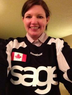 "Erin Thompson feeling her ""honorary Canadian-ness"" in her first ever hockey jersey on the #SageListens RV Tour"