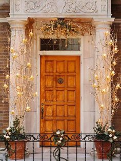 beautiful entry way with twinkle lights and branches