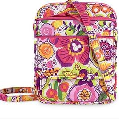 Vera Bradley Disney: Bouncing Bouquet Size small Vera Bradley cross body purchased at the Disney store. It is Disney edition. This cute Vera Bradley bag has Minnie Mouse hidden in the pattern! Bought at the Disney store at Walt Disney! Used once! Vera Bradley Bags Crossbody Bags