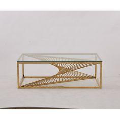 ХОЛНА МАСА 130 СМ/ ЗЛАТО LIVING ROOM TABLE 130 CM / GOLD Холна маса със златна геометрична основна и прозрачен стъклен плот. Този модел прилича повече на произведение на изкуството, отколкото на функционална мебел. Основата има геометричен, скулптурен дизайн за артистично усещане и се отличава с конструкция от неръждаема стомана с богато златно тонално покритие за бляскава презентация. Ясният плот на масата е направен от дебело стъкло, така че да бъде жилав и издръжлив, но в същото време…