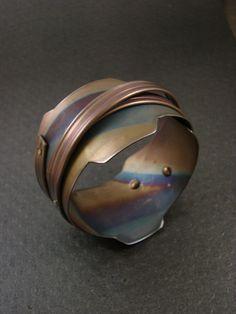 Bracelet | Mirek Gomolka. Titanium sheet and anodazed copper rivets