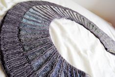 """Westknits' new """"Spectra"""" shawl. The grey and blue and the crescent shape - everything works together so brilliantly. Eagerly hoping to cast-on for this soon!"""