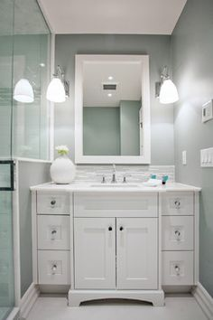 Wall color is Silver Strand from Sherwin Williams.  Gray green color with a very slight hint of blue.  You can see the color better in the mirror. One of my favorites.