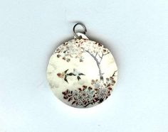 Flying Birds Pendant by design mosaic. Two birds fly by a tree. Made from polymer clay. The image is from antique Japanese satsuma pottery. #handmade #jewelry