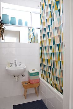 Small but functional bathroom with shower curtain from Ferm Living.  Jo's Understated Retro Rock Style