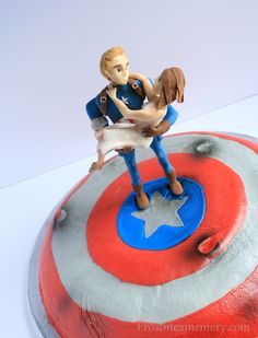 Captain America buttercream shield cake with battle damage! Fondant Captain America saving the girl and the day!