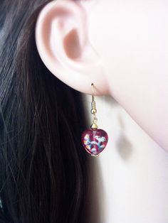 Heart shaped glass earrings with a beautiful flower by Bleuberie, $10.00