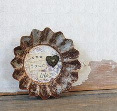 Repurposed Vintage Tart Tin Magnet Love Your Life. $14.00, via Etsy.