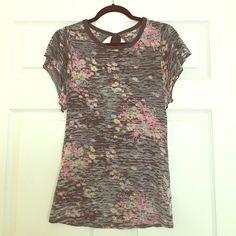 Free People Keyhole Tee Black/gray/multi colored Free People tee with keyhole tie back. Short sleeves are loose and flowy while actual tee is pretty fitted. Used but in like new condition. Free People Tops Tees - Short Sleeve