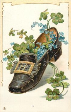 black shoe with big gold pattern on front, containing shamrock and forget-me-nots