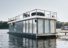 The Boathouse: a new definition to lakefront living! Pontoon Houseboat, Houseboat Living, Wood Boat Plans, Boat Building Plans, Green Building, Sustainable Architecture, Residential Architecture, Floating Architecture, Contemporary Architecture